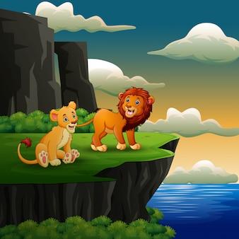 Dibujos animados de leones rugiendo en el fondo del acantilado