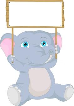 Dibujos animados lindo bebé elefante con signo en blanco
