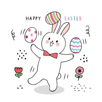 Dibujos animados lindo día de pascua conejo y huevos coloridos