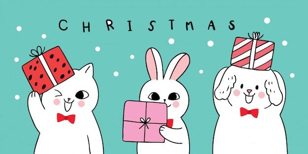 Dibujos animados lindo navidad perro y gato y conejo llevan regalo.