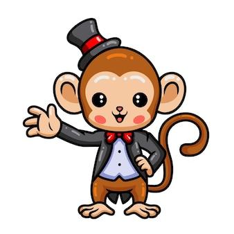 Dibujos animados de mago lindo bebé mono agitando la mano