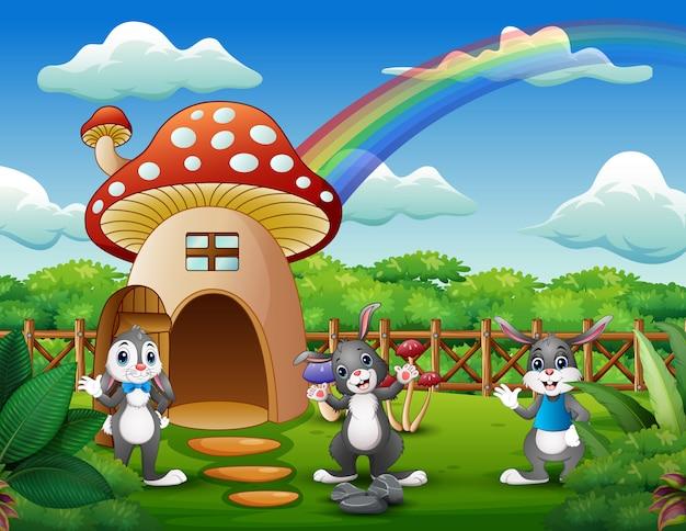 Dibujos animados de muchos conejos cerca de la casa seta roja
