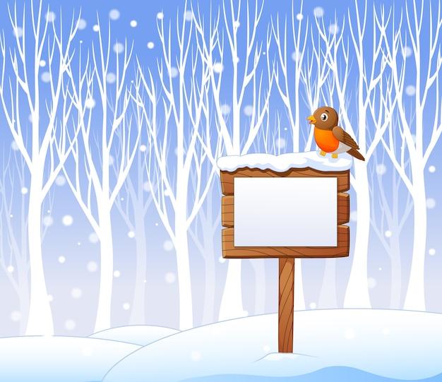 Dibujos animados de pájaro robin en el cartel en blanco con fondo de invierno