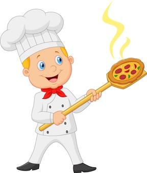 Dibujos animados pequeño chef sosteniendo la herramienta