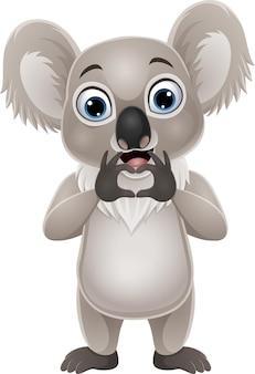 Dibujos animados de pequeño koala haciendo gesto de corazón de mano