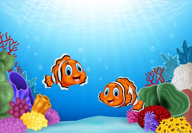 Dibujos animados de pez payaso con hermoso mundo submarino