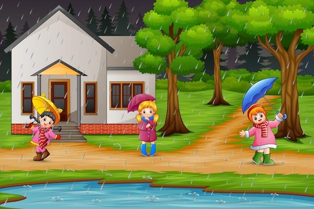 Dibujos animados de tres niña con paraguas