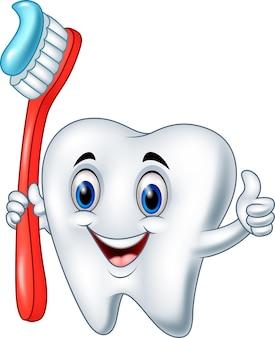 Diente de dibujos animados sosteniendo un cepillo de dientes dando pulgar