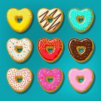 Diferentes donas dulces. lindo y brillante juego de donas en forma de corazón.
