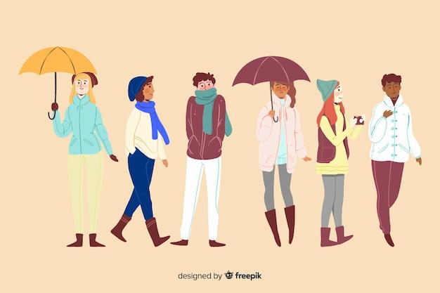 Diferentes personas en el parque otoño