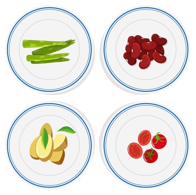 Diferentes vegetales en platos redondos.