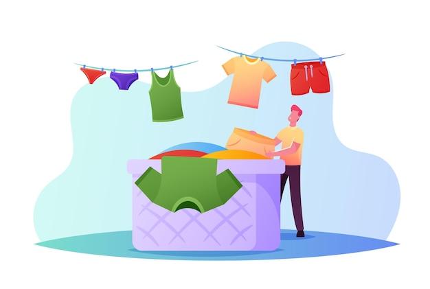Diminuto personaje masculino colgando ropa limpia y húmeda en una cuerda para secar tomando ropa de cama lavada de una enorme canasta en el baño o en la lavandería