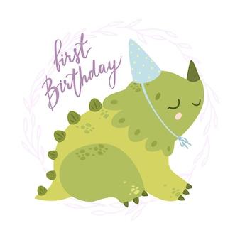 Dinosaurio con gorro de fiesta y texto: primer cumpleaños