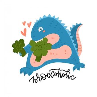 Dinosaurio lindo y sonriente que muerde el brócoli. a dino le encantan las verduras. concepto plano de comida sana con cita de letras broccoholic.
