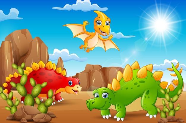 Dinosaurios felices de dibujos animados que viven en el desierto