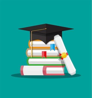 Diploma de papel con sello, libros y gorro de graduación