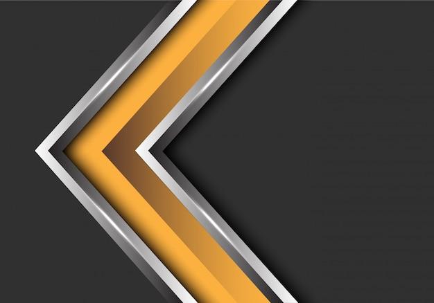 Dirección de la flecha de plata amarilla sobre fondo gris espacio en blanco.
