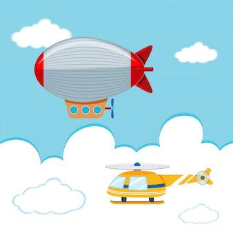 Dirigible no rígido y helicóptero en el cielo