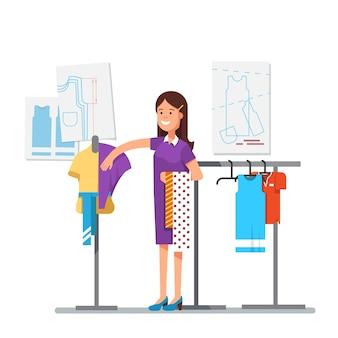 Diseñador de ropa de moda que trabaja en el proyecto de vestido