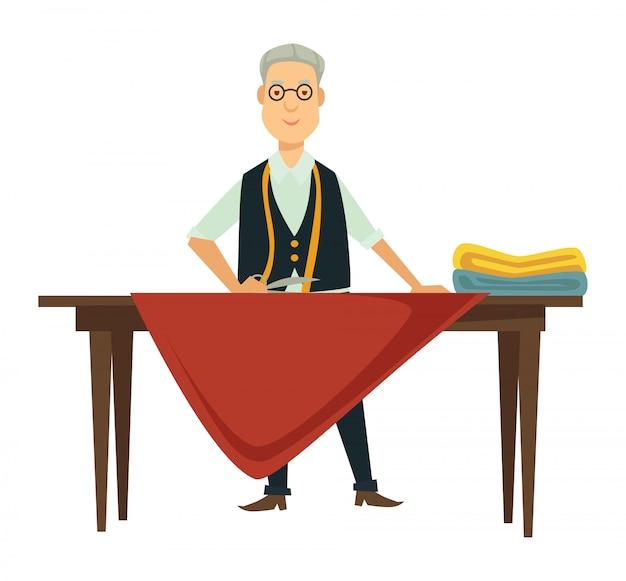 Diseñador masculino trabaja en un nuevo traje en la mesa