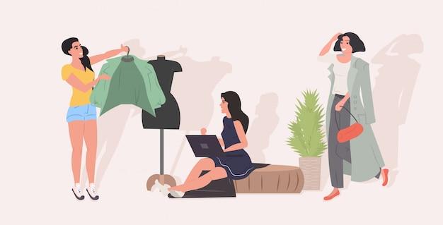 Diseñador tratando de chaqueta de moda maniquí