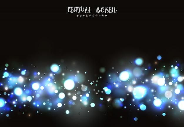 Diseño abstracto azul y blanco de la chispa del bokeh en fondo oscuro.