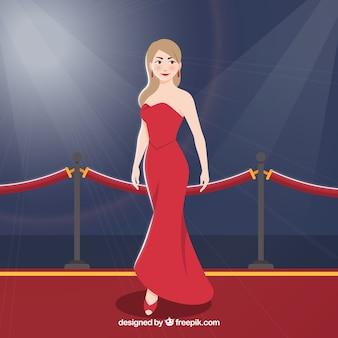 Diseño de alfombra roja con mujer en vestido rojo