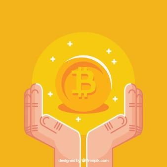 Diseño amarillo de bitcoin con manos