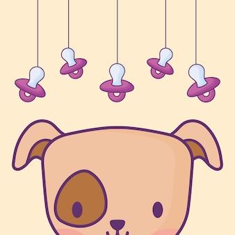 Diseño de baby shower con perro lindo y chupetes colgando