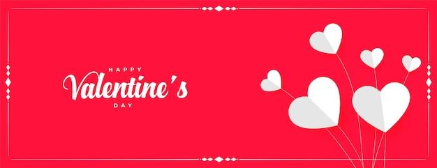 Diseño de banner de corazones de globo de papel de feliz día de san valentín