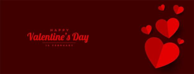 Diseño de banner de corazones de papel de feliz día de san valentín