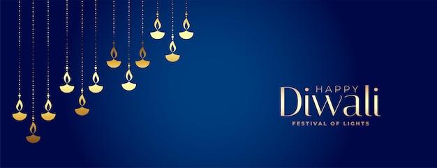 Diseño de banner de diya dorado decorativo premium