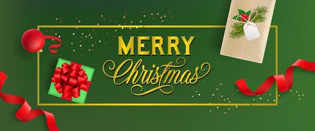 Diseño de banner de feliz navidad. adorno navideño, cajas de regalo.