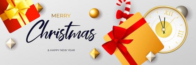 Diseño de banner de feliz navidad con caja de regalo y reloj dorado