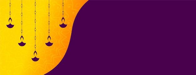 Diseño de banner de festival de diwali de decoración diya colgante