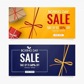 Diseño de banner o tarjeta de regalo amarillo y azul con cajas de regalo y diferentes ofertas de descuento para la venta del día del boxeo.