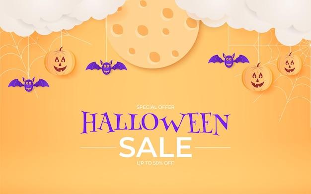 Diseño de banner de venta de halloween con estilo de corte de papel para promoción.