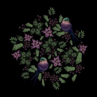 Diseño de bordado en punto satinado con pájaros y flores.