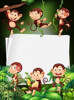 Diseño de borde con monos en el bosque