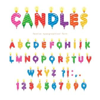 Diseño colorido de la fuente de las velas del cumpleaños