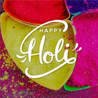 Diseño colorido con letras holi felices