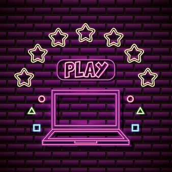 Diseño de computadora portátil y estrellas en estilo neón, videojuegos relacionados