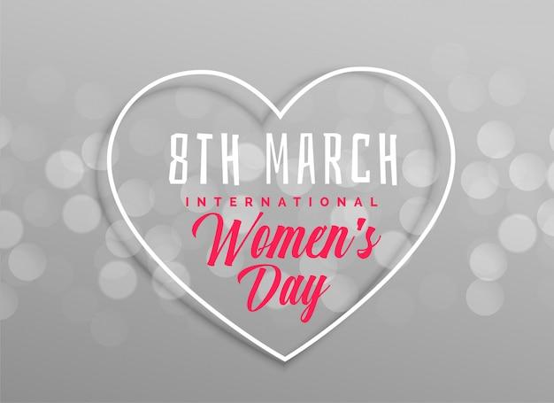 Diseño del corazón del día de las mujeres felices en fondo gris