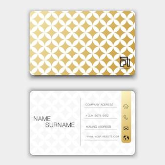 Diseño creativo de la tarjeta de visita en el fondo gris.