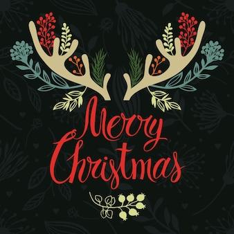 Diseño de la cubierta de la postal de las cornamentas de la navidad. caligrafía y hierbas del bosque