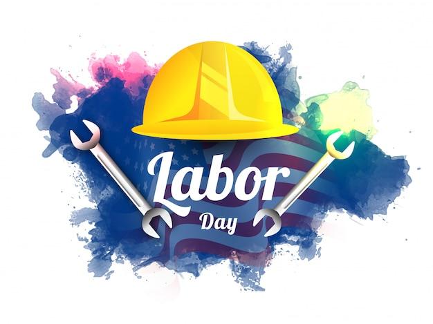 Diseño del día del trabajo con casco de trabajador y herramienta de llave inglesa en bandera americana ondulada y efecto de salpicaduras de acuarela.