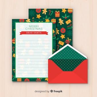 Diseño flat de sobre y carta de navidad
