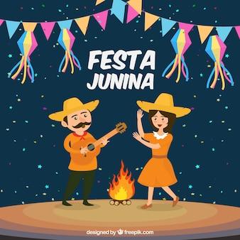 Diseño de fondo de festa junina con hoguera y pareja bailando