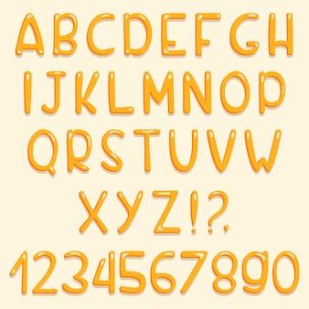 Diseño de fuente brillante. abc amarillo letras y números.