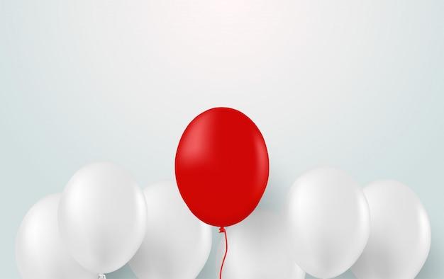Diseño con globo blanco y globos rojos.